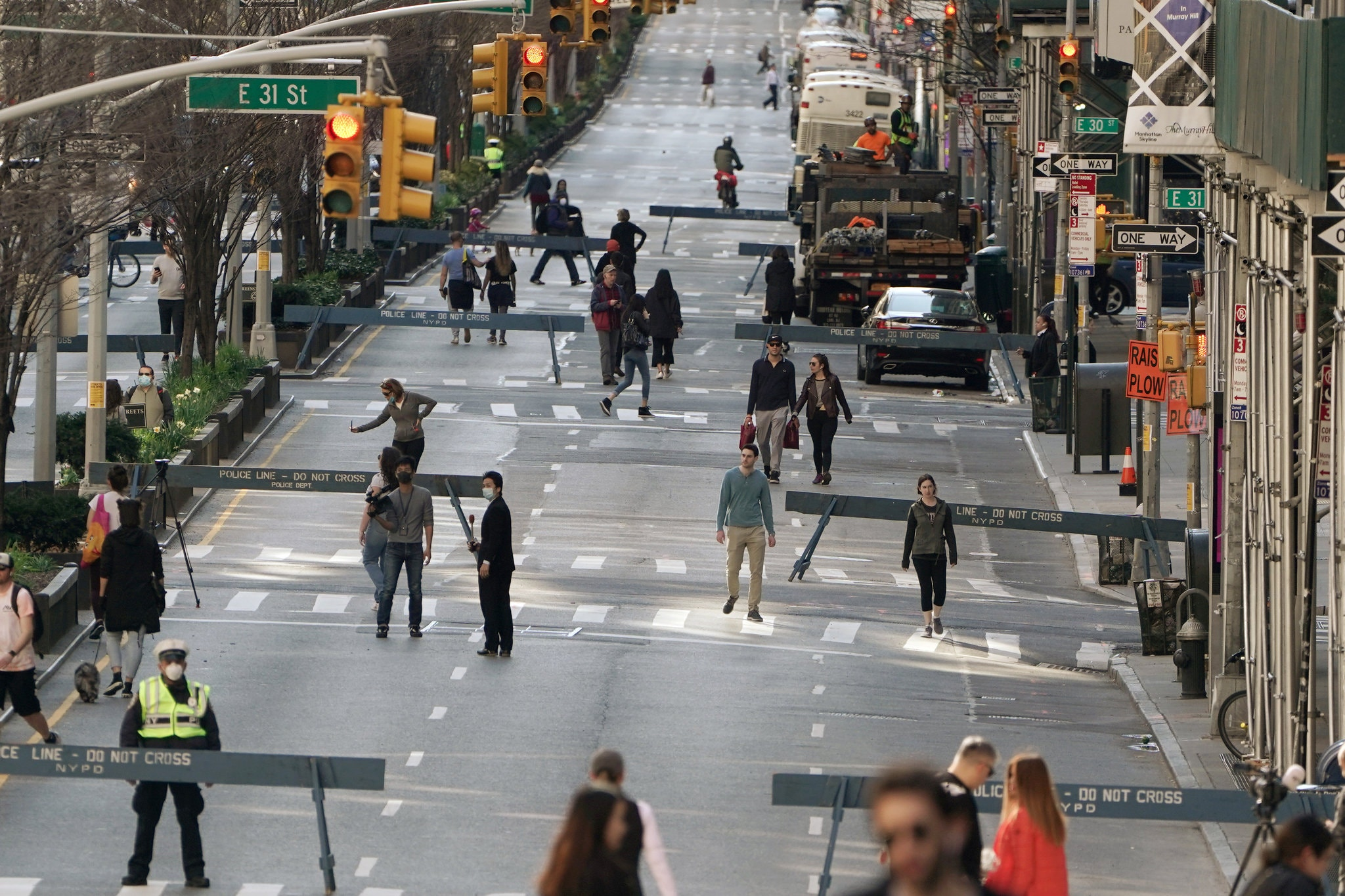 Part of Park Avenue in Manhattan was closed to vehicle traffic on March 27 to give pedestrians more outdoor space — and spacing.Credit...Carlo Allegri/Reuters