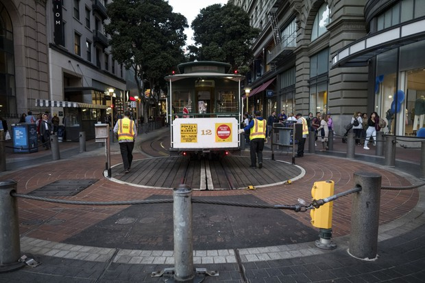 San Francisco Municipal Transit Agency employees turn an empty cable car in San Francisco on March 4. The city has taken advantage of the commuting and tourism lull to complete transportation-related construction projects. David Paul Morris/Bloomberg